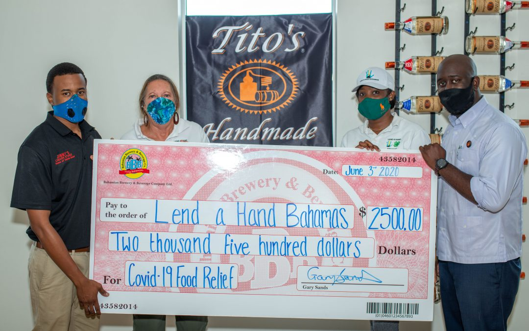 Bahamian Brewery and Tito's Handmade Vodka 'Lend a Hand' in the fight against COVID-19.